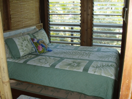 Queen size bamboo bed in master bedroom, Pualani Home, Kapoho, Hawaii