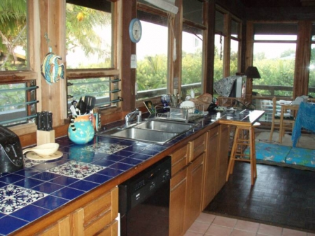 Pualani Vacation Home kitchen with tropical and ocean views