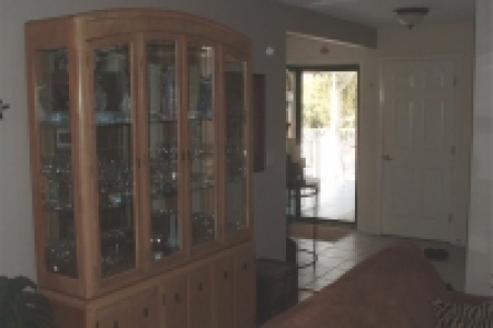 foyer- beautiful wood floors and upgraded furniture