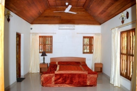 Furnished bedrooms with a/c, attached bathrooms & a sea view