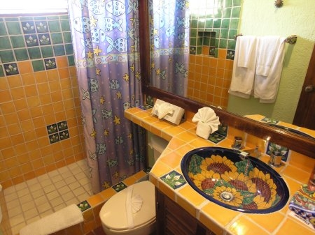 Bathroom with Colorful Native Tiles and Hand Painted Sink